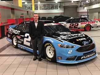 McCauley and the car that produced Team Penske's 100th NASCAR victory