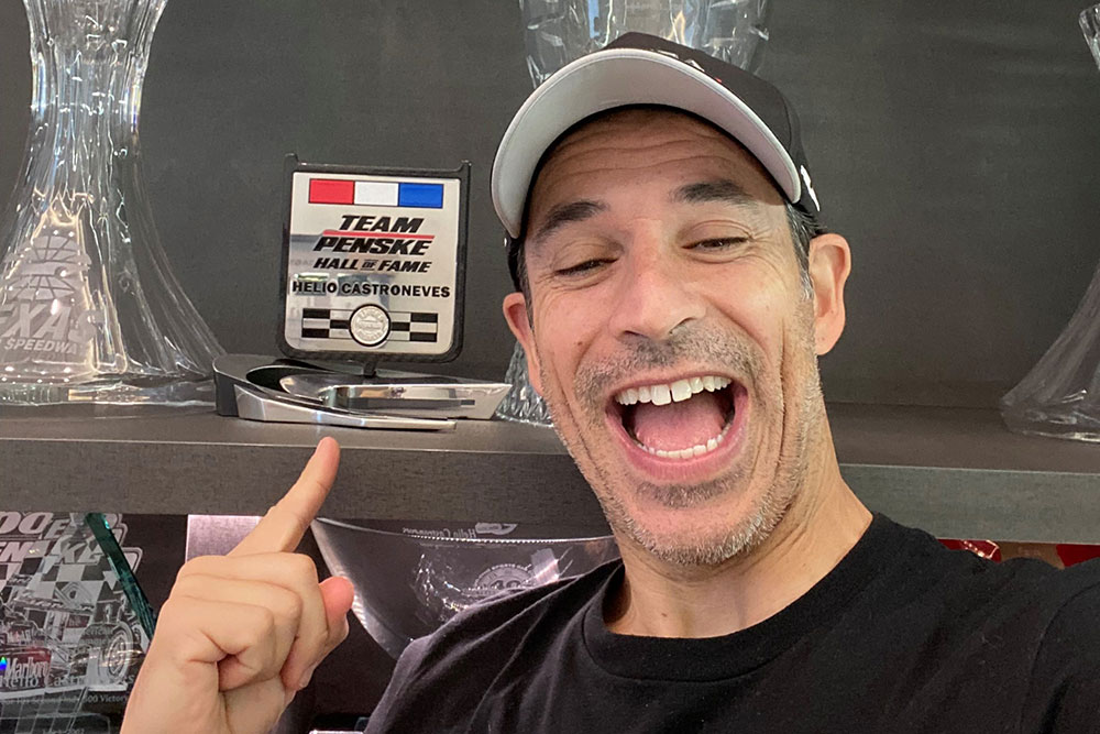 Helio Castroneves proudly displays his Team Penske Hall of Fame award at his home in Florida.