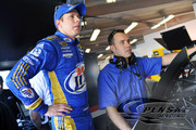 Keselowski and crew chief Paul Wolfe go over some data