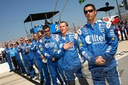 The Alltel crew stands at attention for the National Anthem at Richmond