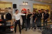 Helio Castroneves shows his moves off to fellow Penske Racing drivers Ryan Briscoe, Sascha Maassen, Pat Long, Romain Dumas and Timo Bernhard