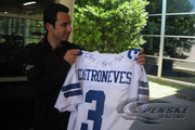 The Dallas Cowboys present Helio Castroneves with a jersey during a promo day in Dallas